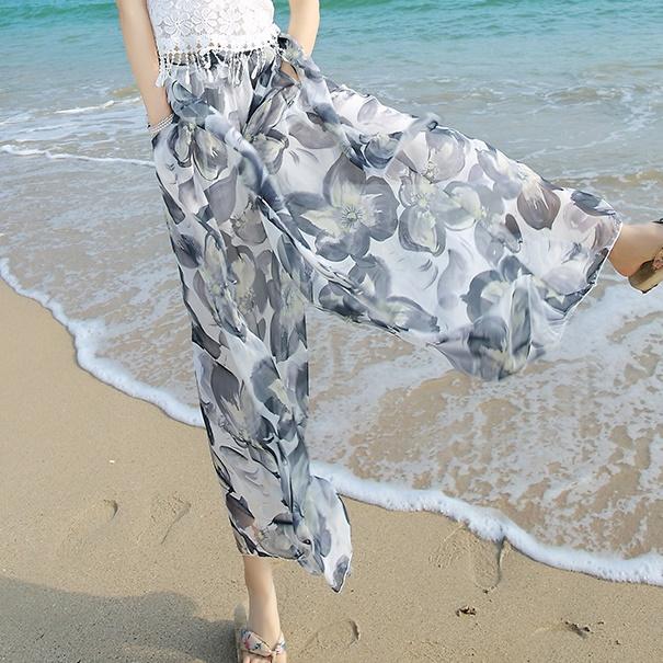 กางเกงขายาวแฟชั่นชายทะเล ลายดอกไม้สีขาว (2017 Korean version of the resort beach wide leg pants chiffon seven nine pants skirt pants straight was thin thin female pants)