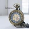 นาฬิกาตลับระบบกลไกไขลานแบบโบราณสีทองเหลือง ตรงกลางฝาคริสตัลมองเห็นเครื่องกลไก